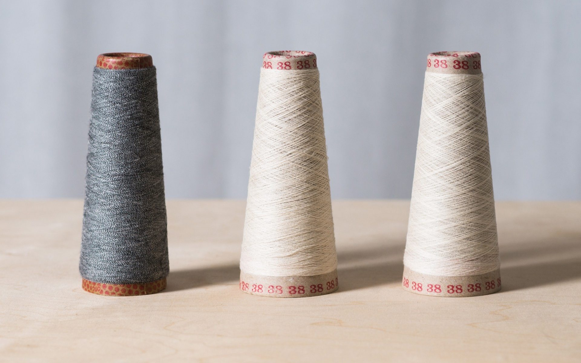 Spools of thread made from regenerated cotton fiber